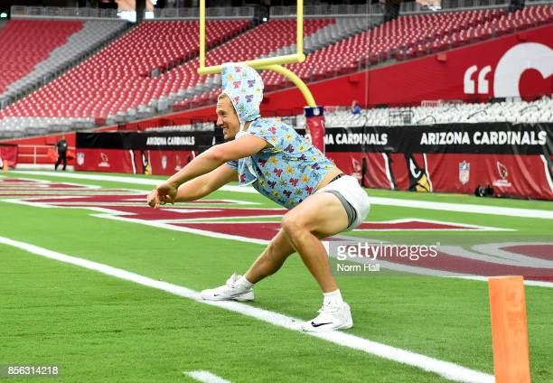 Blaine Gabbert of the Arizona Cardinals takes the field while wearing a baby costume prior to a game against the San Francisco 49ers at University of...