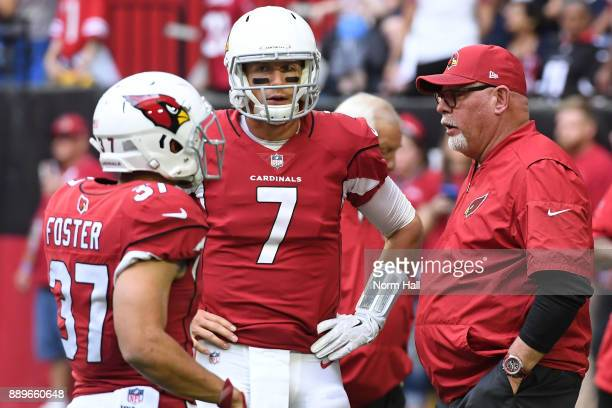 Blaine Gabbert of the Arizona Cardinals talks with head coach Bruce Arians prior to the NFL game against the Tennessee Titans at University of...