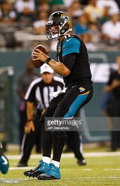 Blaine Gabbert of the Jacksonville Jaguars scrambles against the New York Jets during their preseason game at MetLife Stadium on August 17 2013 in...