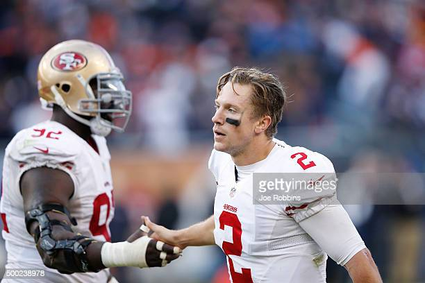 Blaine Gabbert of the San Francisco 49ers celebrates after rushing for a 44yard touchdown to tie the game in the fourth quarter against the Chicago...
