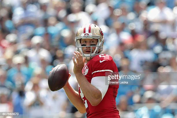 Blaine Gabbert of the San Francisco 49ers drops back to pass against the Carolina Panthers during their game at Bank of America Stadium on September...