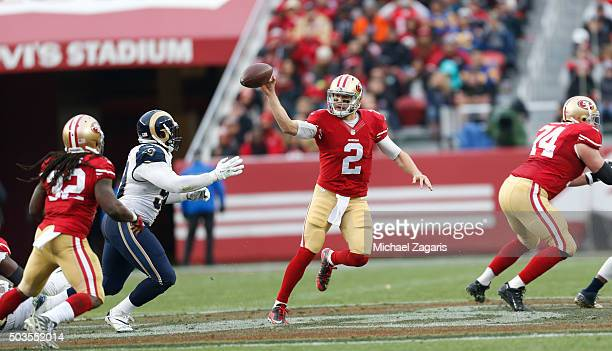 Blaine Gabbert of the San Francisco 49ers dumps the ball off to DuJuan Harris during the game against the St Louis Rams at Levi Stadium on January 3...