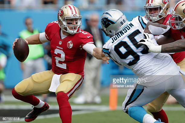 Blaine Gabbert of the San Francisco 49ers scrambles from Charles Johnson of the Carolina Panthers in the 2nd quarter during their game at Bank of...