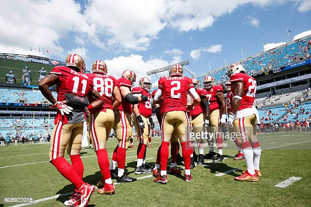 Blaine Gabbert of the San Francisco 49ers talks with the offense on the field prior to the game against the Carolina Panthers at Bank of America...