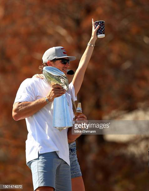 Blaine Gabbert of the Tampa Bay Buccaneers celebrates their Super Bowl LV victory with the Vince Lombardi trophy during a boat parade through the...