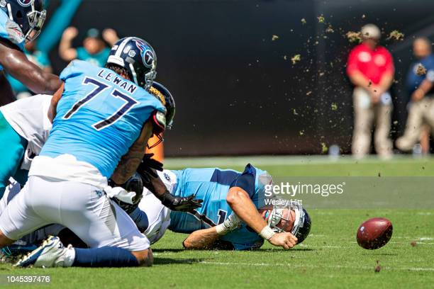 Blaine Gabbert of the Tennessee Titans is hit and fumbles the ball along with hitting his head on the ground and getting a concussion during a game...
