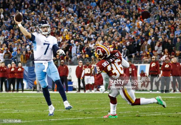 Blaine Gabbert of the Tennessee Titans throws a touchdown pass to beat the Washington Redskins while defended by DJ Swearinger of the Washington...