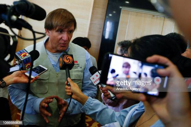 Blaine Gibson the selfstyled wreck hunter searching for missing Malaysian Airlines flight MH370 talks to media members after handing over pieces of...