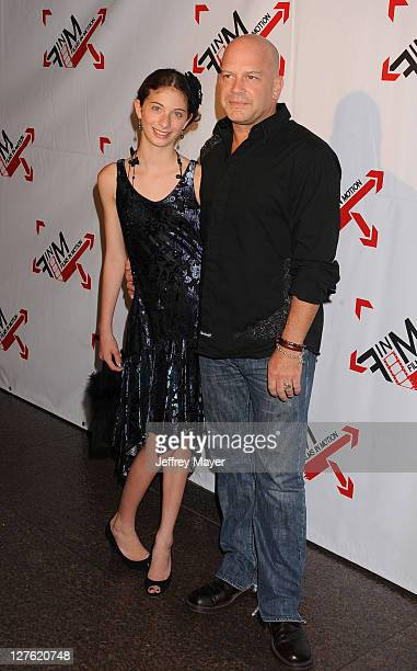 Blaine McManus and daughter Mia Sara McManus arrive at the World Premiere of Blood Out at Directors Guild Of America on April 25 2011 in Los Angeles...