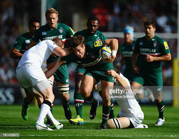 Blaine Scully of Leicester Tigers is tackled by Rory Clegg and Mark Wilson of Newcastle Falcons during the Aviva Premiership match between Leicester...