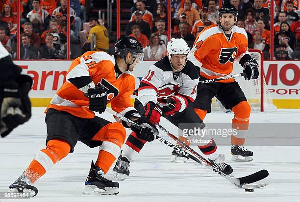 Blair Betts of the Philadelphia Flyers skates against Dean McAmmond of the New Jersey Devils in Game Four of the Eastern Conference Quarterfinals...