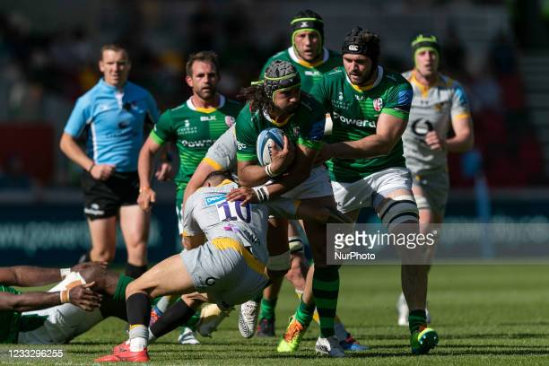 Blair Cowan of London Irish is tackled by Jacob Umaga of Wasps during the Gallagher Premiership match between London Irish and Wasps at the Brentford...