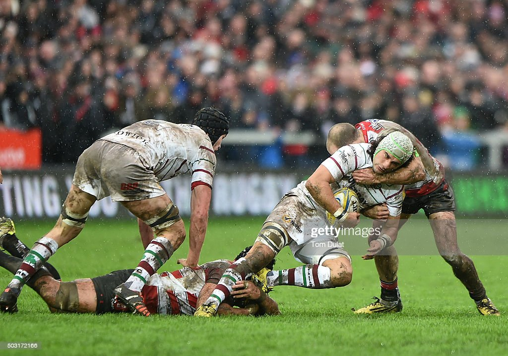 Blair Cowan of London Irish is tackled during the Aviva Premiership match between Gloucester Rugby and London Irish at Kingsholm Stadium on January 2, 2016 in Gloucester, England. (Photo by Tom Dulat/Getty Images).