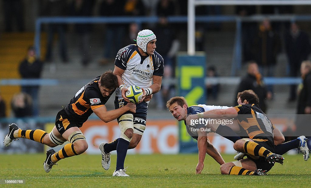 Blair Cowan of Worcester Warriors is tackled during the LV= Cup match between London Wasps and Worcester Warriors at Adams Park on November 18, 2012 in High Wycombe, England.
