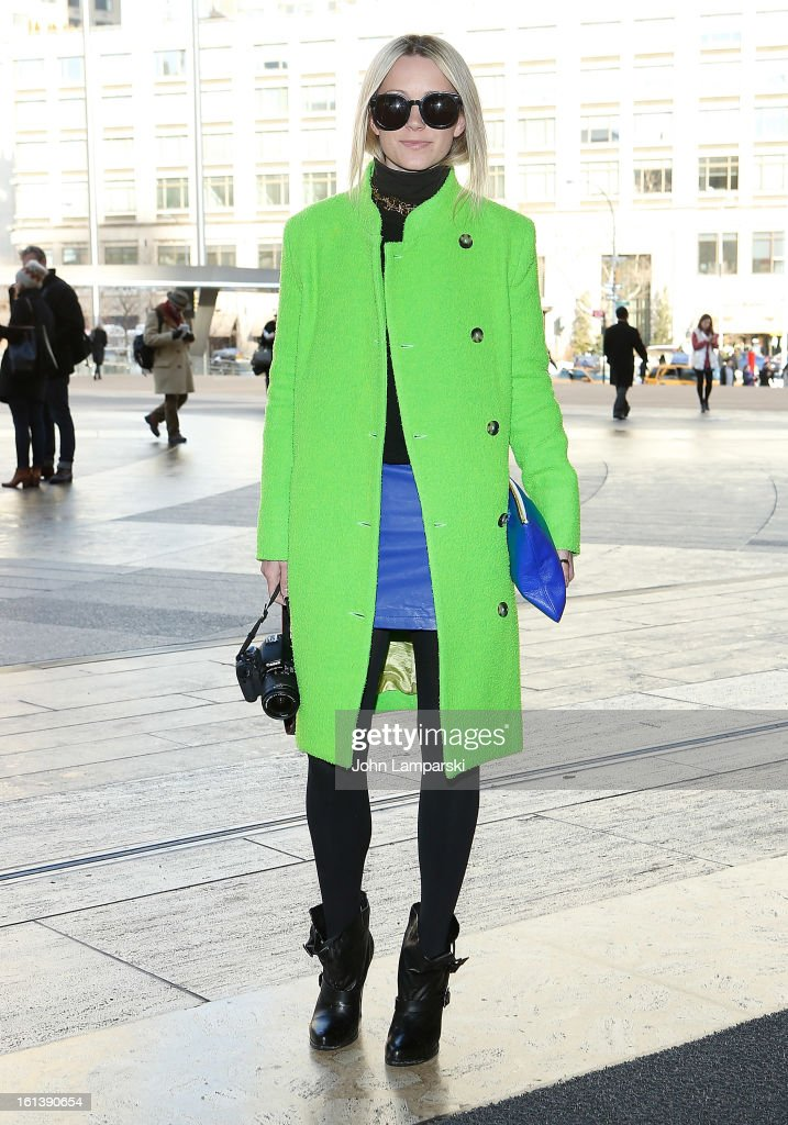 Blair Eadie is seen wearing a coat by Acme, Furlane sweater, Forever 21 skirt, Givenchy shoes and Karen Walker glasses at Lincoln Center Plaza on February 10, 2013 in New York City.