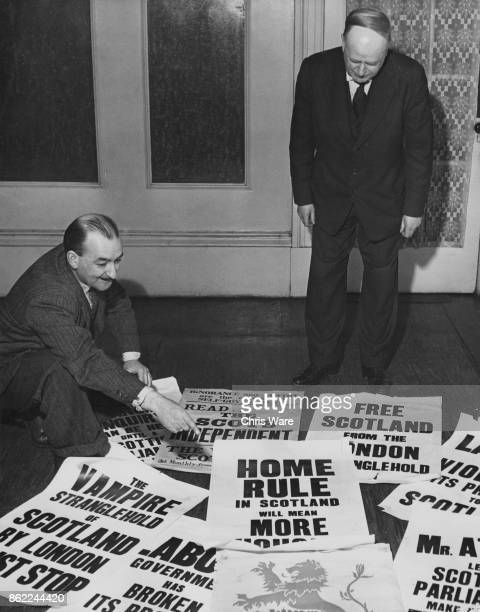 Blair Henderson shows Tom Gibson President of the Scottish National Party some of the new 'Home Rule for Scotland' posters at the SNP headquarters in...