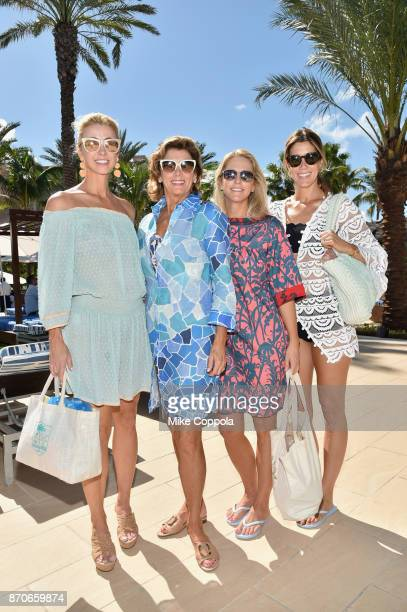 Blair Husain and Kathryn McClure pose with guests at the weekend opening of The NEW ultraluxury Cove Resort at Atlantis Paradise Island on November 4...
