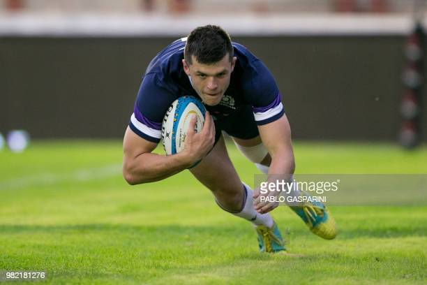 Blair Kinghorn from Scotland dives to score a try during their international test match against Argentina at the Centenario stadium in Resistencia...