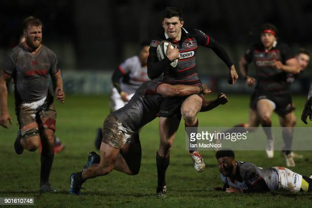 Blair Kinghorn of Edinburgh Rugby is tackled by Ntabeni Dukisa of Southern Kings during the Guinness Pro14 match between Edinburgh Rugby and Southern...