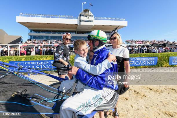 Blair Orange driving Cruz Bromac receives a hug from his son Harrison after winning Race 10 Christchurch Casino New Zealand Trotting Cup during the...