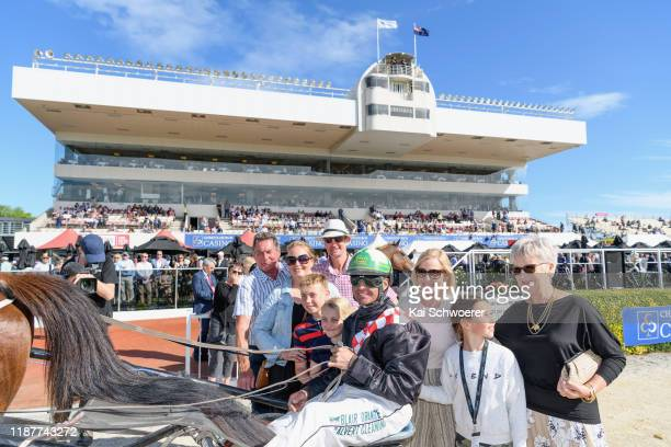 Blair Orange driving Habibi Inta poses with the owners after winning Race 9 Airpark Canterbury Dominion Stabd Trot during the Show Day Races at...