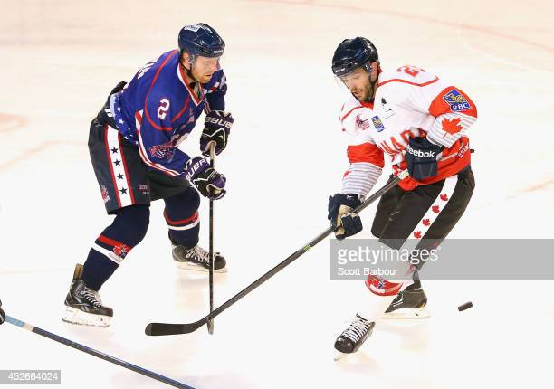 Blair Riley of Canada and Kevin Ryan of the USA compete for the puck during the International Ice Hockey Series match between the United States and...