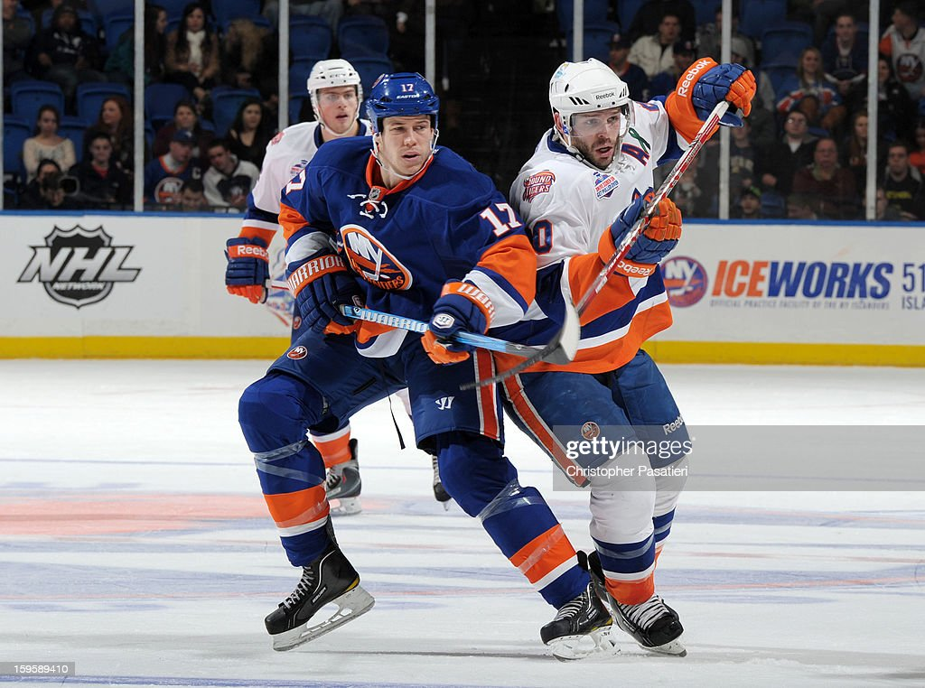 Blair Riley #20 of Team White faces off against Matt Martin #17 of Team Blue during a scrimmage match between players of the New York Islanders and Bridgeport Sound Tigers on January 16, 2013 at Nassau Veterans Memorial Coliseum in Uniondale, New York.