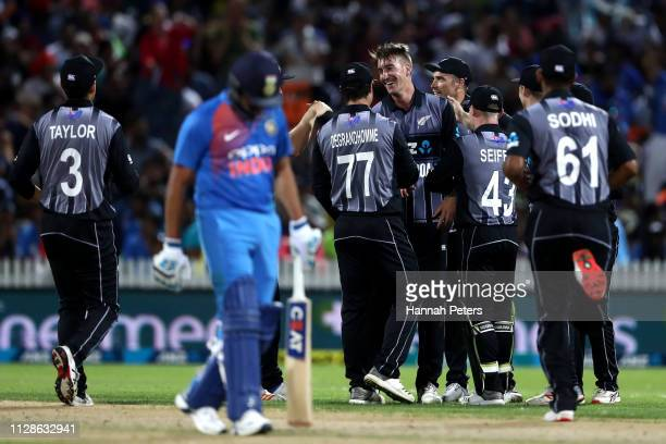 Blair Tickner of the Black Caps celebrates the wicket of Rishabh Pant of India during the International T20 Game 3 between India and New Zealand at...