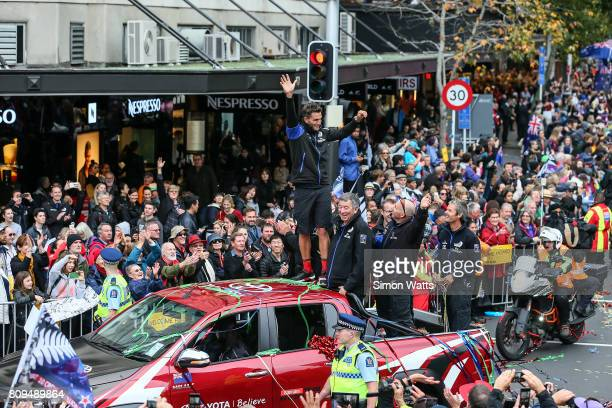 Blair Tuke of Team New Zealand celebrates during the Team New Zealand Americas Cup Welcome Home Parade on July 6 2017 in Auckland New Zealand