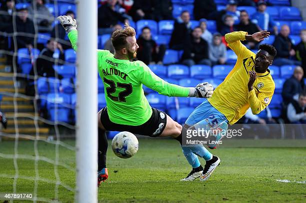 Blair Turgott of Coventry City beats Ben Alnwick of Peterborough United to score a goal during the Sky Bet League One match between Peterborough...