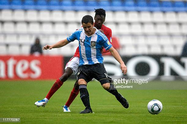 Blair Turgott of England struggles for the ball with Alexis Zarate of Argentina during the FIFA U17 World Cup Mexico 2011 Round of 16 match between...