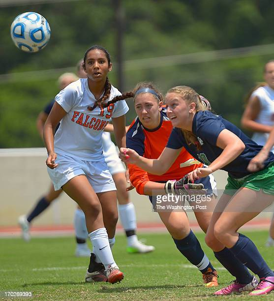 Blairwood's Mia Venkat left watches her goalie Tori Riopelle center get beaten bo Woodgrove's Ashley Bonner for a late 1st half goal as Woodgrove...