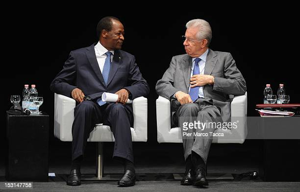 Blaise Compaore President of Burkina Faso and Italian Prime Minister Mario Monti attend the Forum of International Cooperation at Piccolo Teatro...