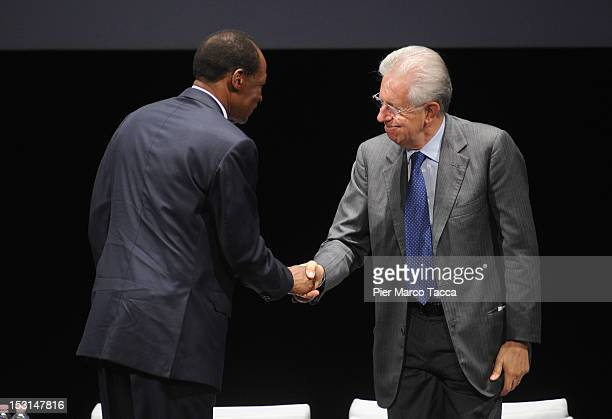 Blaise Compaore President of Burkina Faso shakes hands with Italian Prime Minister Mario Monti at the Forum of International Cooperation at Piccolo...