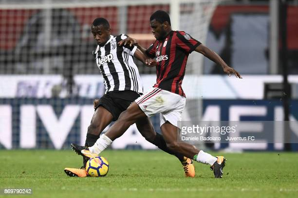 Blaise Matuidi and Franck Kessie during the Serie A match between AC Milan and Juventus at Stadio Giuseppe Meazza on October 28 2017 in Milan Italy