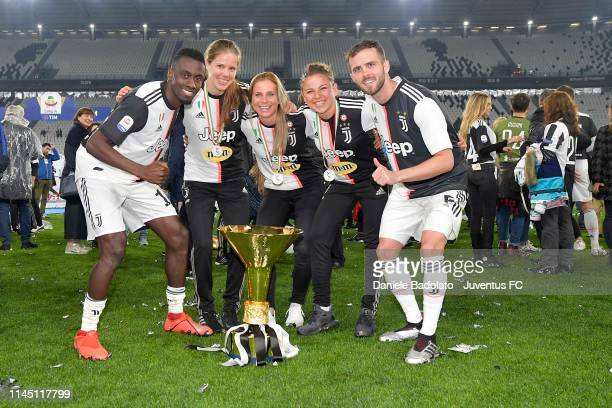 Blaise Matuidi and Miralem Pjanic of Juventus celebrate with Juventus Women team after winning the Serie A Championship 20182019 at the end of the...