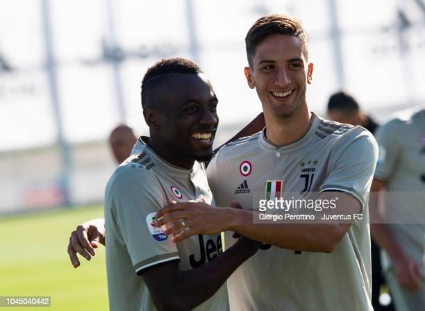 Blaise Matuidi and Rodrigo Bentancur smile during the Juventus Official Team Photo at JTC on October 3 2018 in Turin Italy