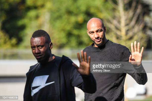 Blaise Matuidi and Steven Nzonzi of France arrives for the training session of the France soccer team at Centre National du Football on October 8...