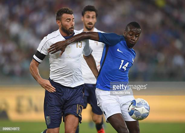 Blaise Matuidi of France and Andrea Barzagli of Italy compete for the ball during the international friendly match between Italy and France at Stadio...