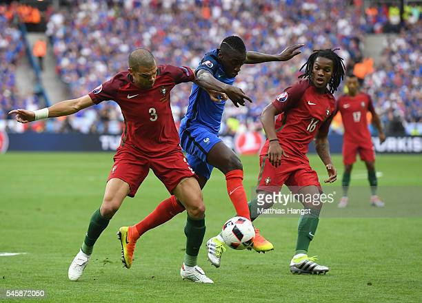 Blaise Matuidi of France competes for the ball against Pepe and Renato Sanches of Portugal during the UEFA EURO 2016 Final match between Portugal and...