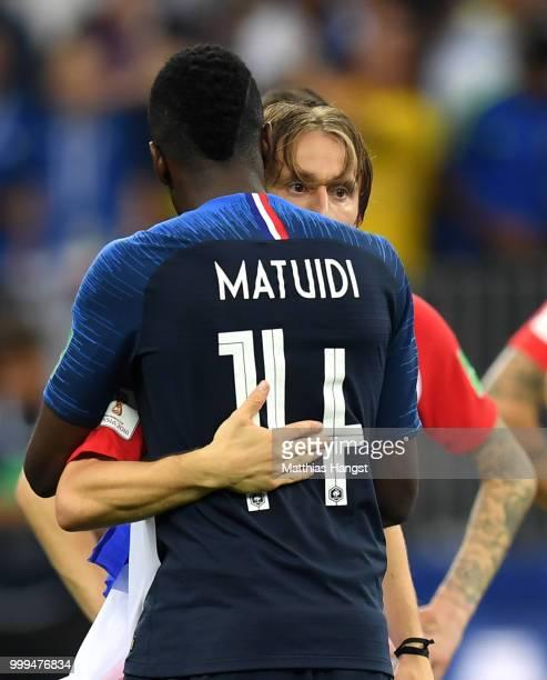 Blaise Matuidi of France embraces Luka Modric of Croatia following the 2018 FIFA World Cup Final between France and Croatia at Luzhniki Stadium on...