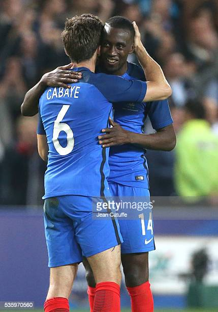 Blaise Matuidi of France greets Yohan Cabaye following the international friendly match between France and Cameroon at Stade de La Beaujoire on May...