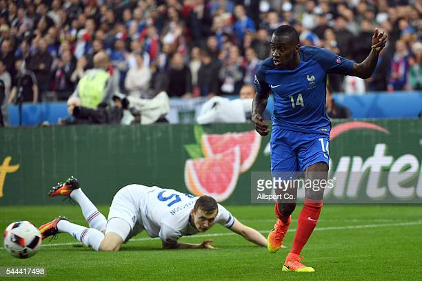 Blaise Matuidi of France holds off Jón Dadi Bödvarsson of Iceland during the UEFA EURO 2016 quarter final match between France and Iceland at Stade...