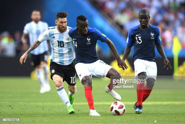 Blaise Matuidi of France is challenged by Lionel Messi of Argentina during the 2018 FIFA World Cup Russia Round of 16 match between France and...