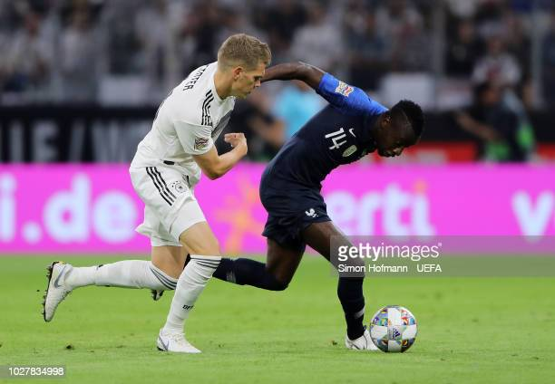 Blaise Matuidi of France is challenged by Matthias Ginter of Germany during the UEFA Nations League Group A match between Germany and France at...
