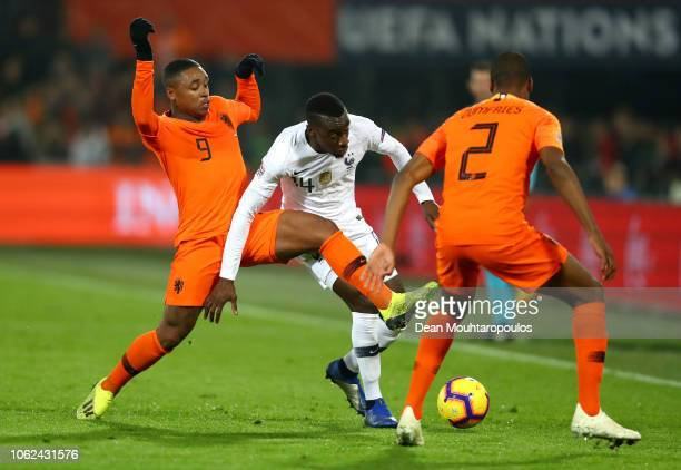 Blaise Matuidi of France is challenged by Steven Bergwijn of the Netherlands and Denzel Dumfries of the Netherlands during the UEFA Nations League...