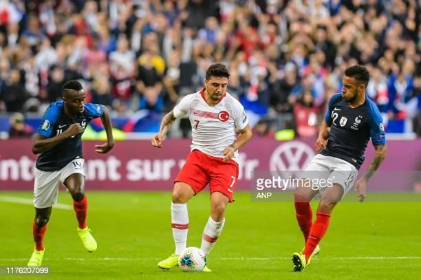 Blaise Matuidi of France Ozan Tufan of Turkey Corentin Tolisso of France during the UEFA EURO 2020 qualifier group C qualifying match between France...