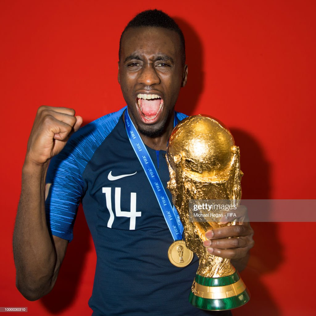 Blaise Matuidi of France poses with the Champions World Cup trophy ...
