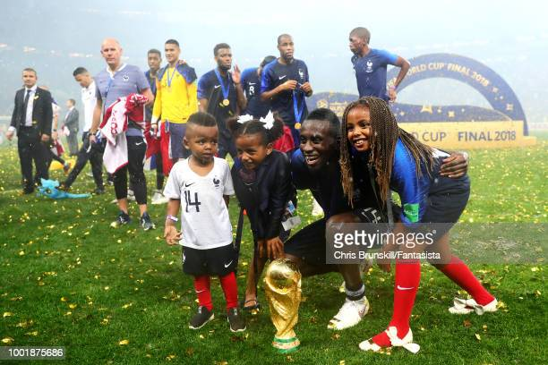 Blaise Matuidi of France poses with the World Cup alongside his daughters following the 2018 FIFA World Cup Russia Final between France and Croatia...