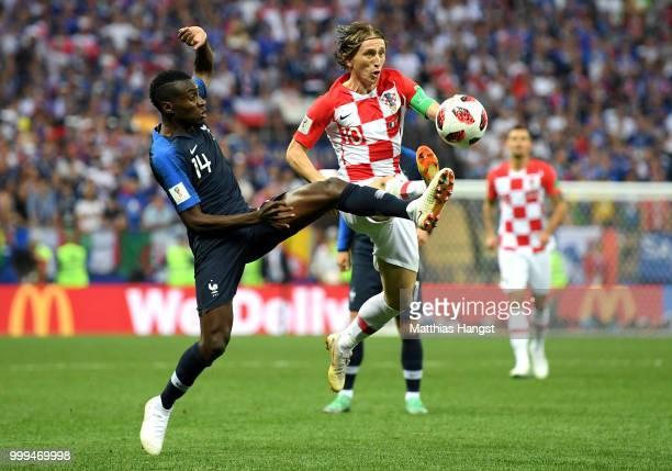 Blaise Matuidi of France tackles Luka Modric of Croatia during the 2018 FIFA World Cup Final between France and Croatia at Luzhniki Stadium on July...